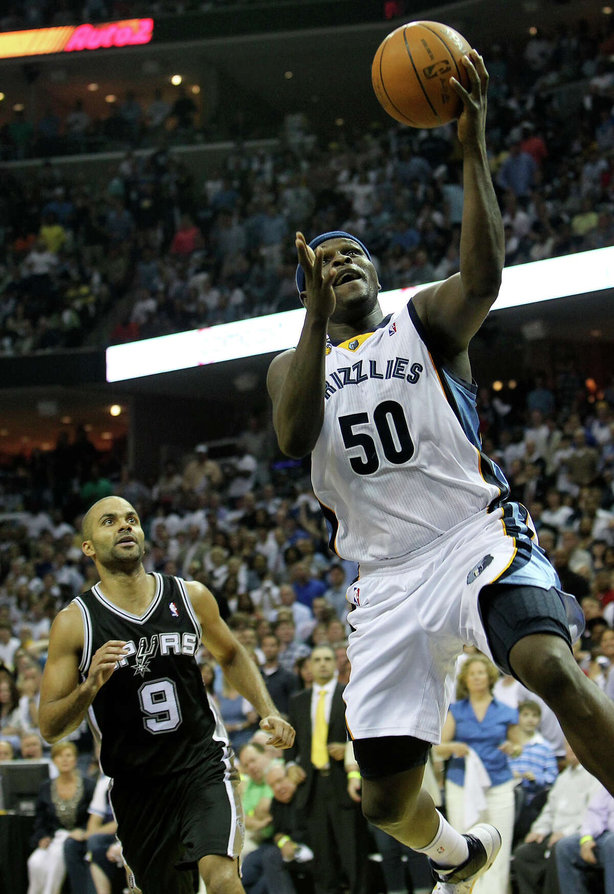 Memphis Grizzlies' Zach Randolph goes in for a score past Spurs' Tony Parker in the second half in Game 6 of the first round of the Western Conference playoffs in 2011.