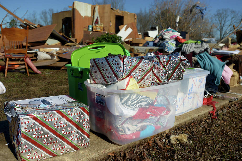 Christmas gifts are stacked outside of a demolished home after a tornado blew through Selmer, Tenn., this week. More severe weather was expected in the state, along with parts of Alabama and Georgia. Photo: Kenneth Cummings /Associated Press / The Jackson Sun