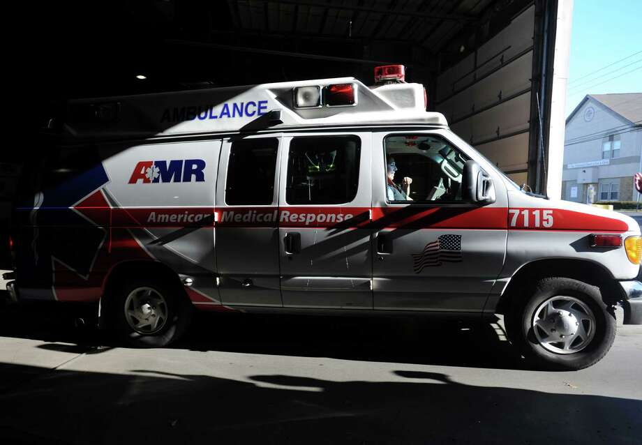 An ambulance pulls out of the bay at AMR's Bridgeport facility Wednesday, Dec. 16, 2015. Photo: Autumn Driscoll / Hearst Connecticut Media / Connecticut Post