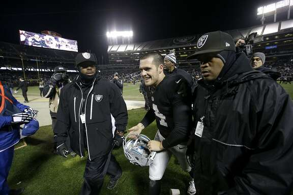 Oakland Raiders quarterback Derek Carr (4) runs off the field after overtime of an NFL football game against the San Diego Chargers in Oakland, Calif., Thursday, Dec. 24, 2015. The Raiders won 23-20. (AP Photo/Marcio Jose Sanchez)