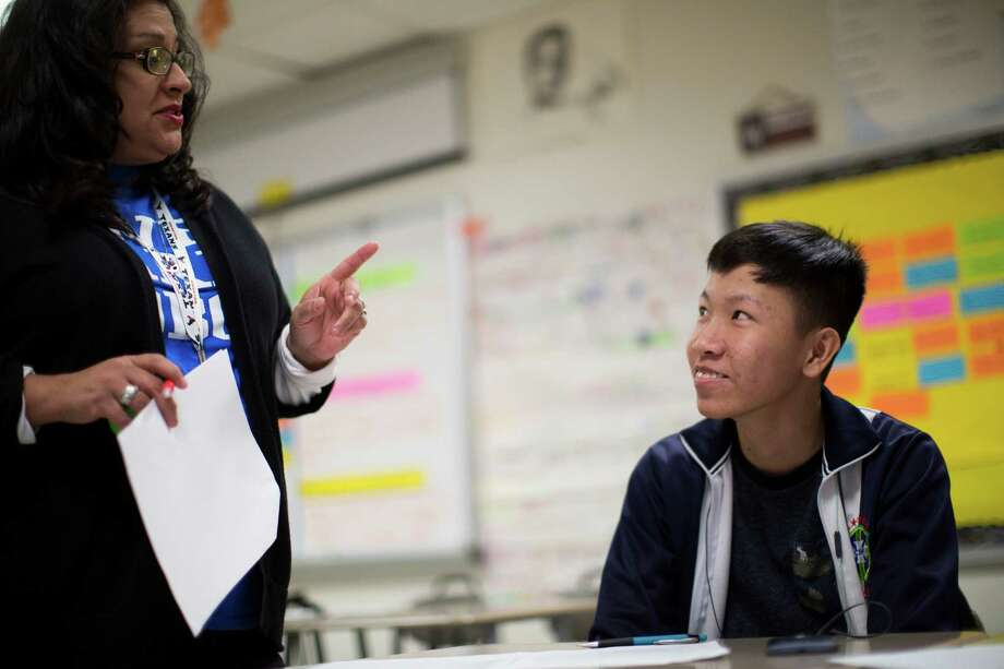 English teacher Sonia Cutaia advises Trung Ngo, left, 17, to use a dictionary instead of Google Translate for accuracy reasons. Ngo moved to the United States from Vietnam this year with his mother and older brother. ( Marie D. De Jesus / Houston Chronicle ) Photo: Marie D. De Jesus, Staff / © 2015 Houston Chronicle