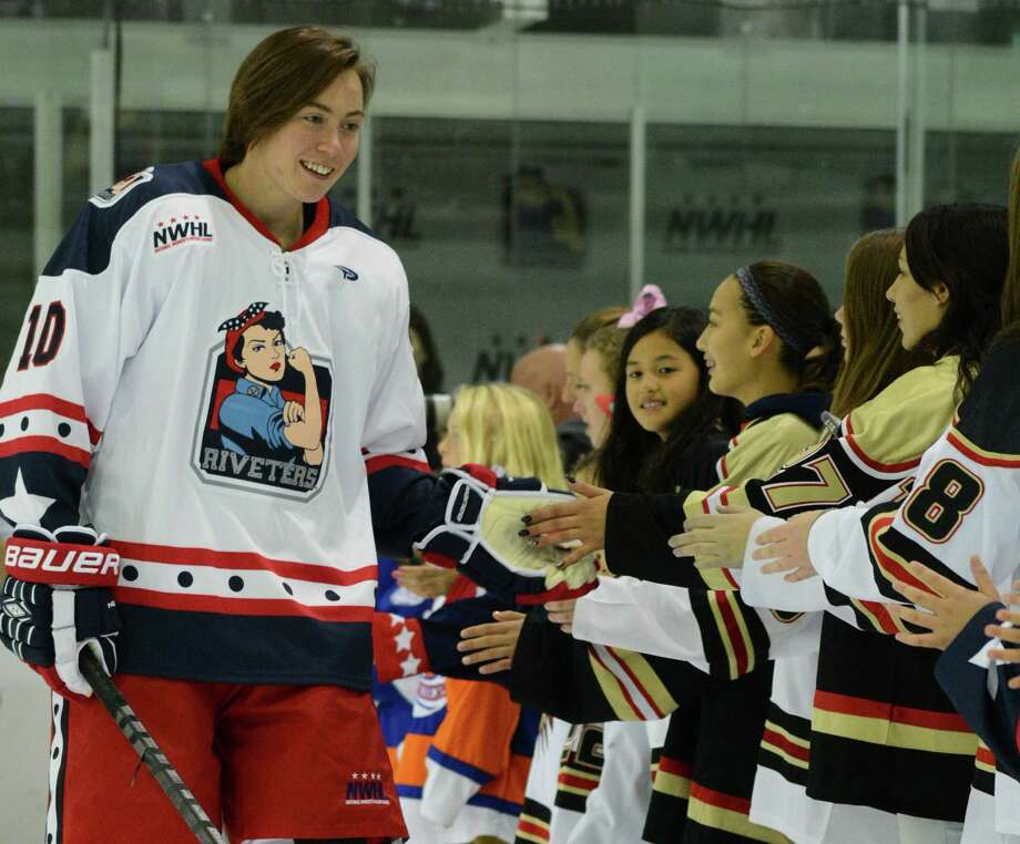 Ashley Johnston, a Union College graduate and Albany resident, plays with the New York Riveters. The Riveters, basedin Brooklyn, N.Y., are part of the new National Women's Hockey League. Here, Johnston meets with young fans. (Photo courtesy of Troy Parla)