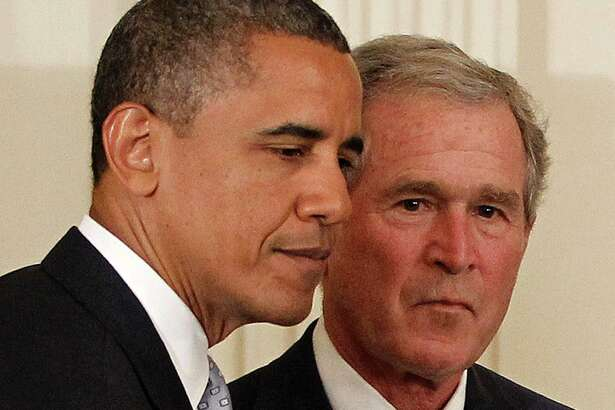"""FILE - In this Thursday, May 31, 2012, file photo, President Barack Obama and former President George W. Bush take part in a ceremony in the East Room of the White House in Washington, to unveil the Bush portrait. Taunted by Republicans to declare war on """"radical Islamic terrorism,"""" Democrats are turning to an unlikely ally: George W. Bush. Obama, under pressure to be more aggressive on terrorism, regularly cites his predecessor's refusal to demonize Muslims or play into the notion of a clash between Islam and the West. It's a striking endorsement from a president whose political rise was predicated on opposition to the Iraq war and Bush's hawkish approach in the Middle East. (AP Photo/Pablo Martinez Monsivais, File)"""