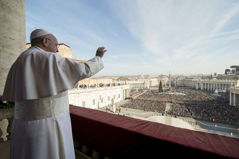 "Pope Francis delivers his ""Urbi et Orbi"" (to the city and to the world) blessing from the central balcony of St. Peter's Basilica at the Vatican, Friday, Dec. 25, 2015. Photo: Associated Press"