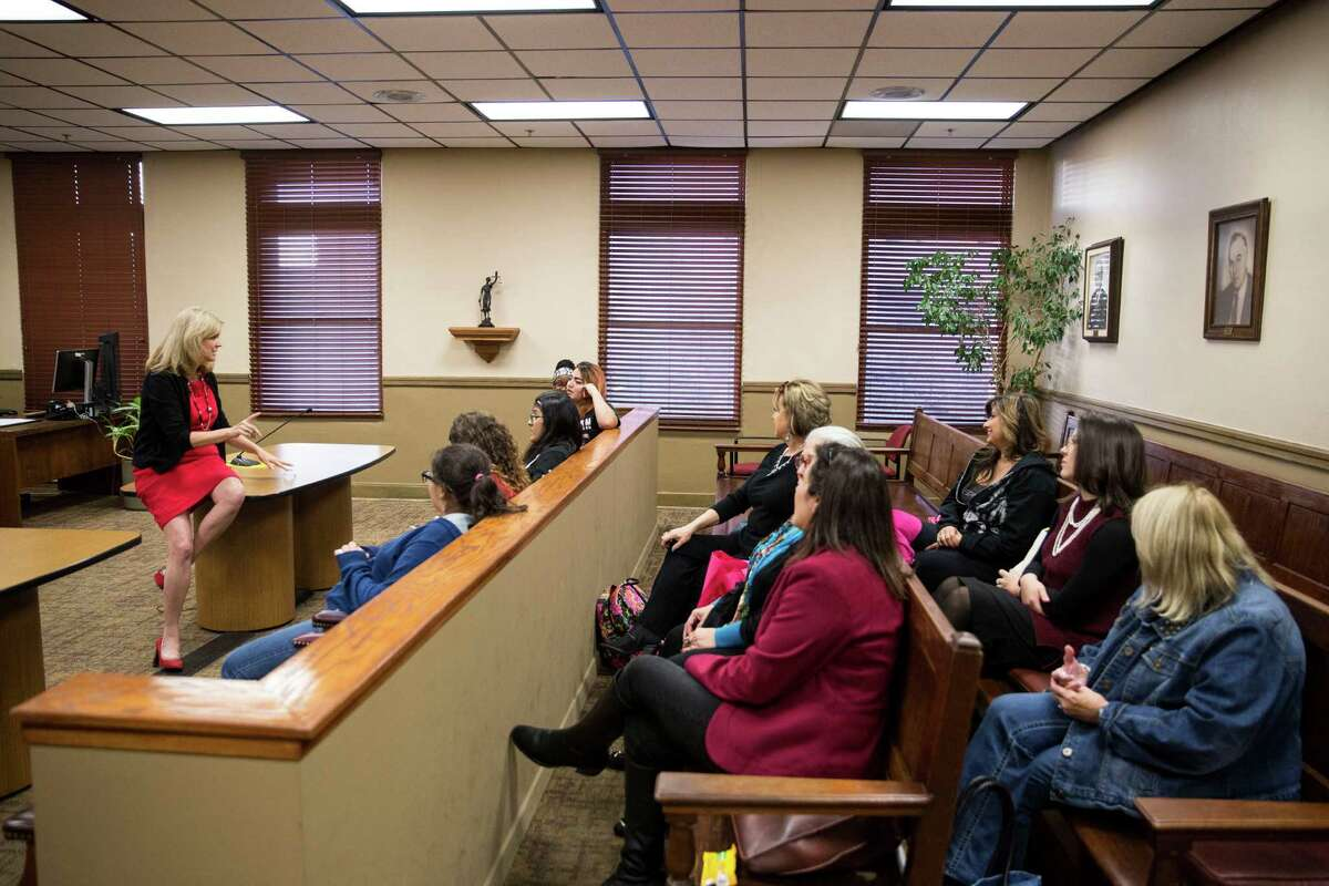 Bexar District Judge Renee Yanta speaks with girls enrolled in the PEARLS program in San Antonio. Yanta started the program in collaboration with Girls Inc. and the Children's Shelter.