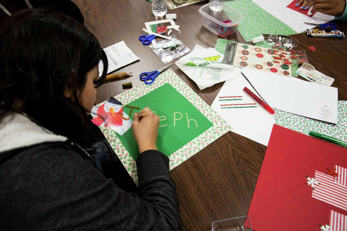 A girl works on a placemat for a resident of the Brookdale Hollywood Park Assisted Living Center during the PEARLS program Dec. 3. As a foster child, she is part of the program to give support and positive direction for girls to stay on the right path and out of the legal system.