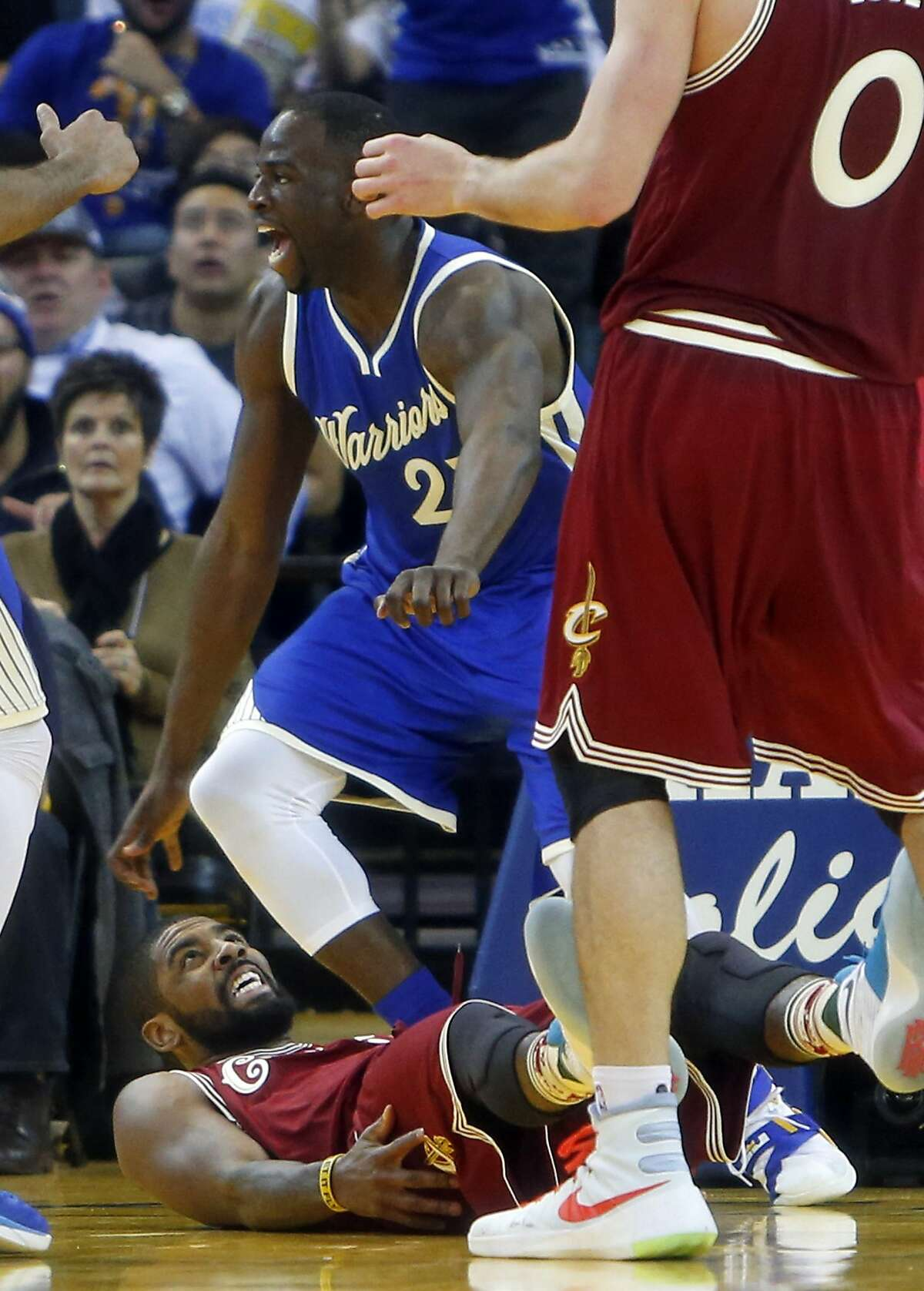 Golden State Warriors' Draymond Green celebrates a basket against Cleveland Cavaliers' Kyrie Irving in 4th quarter of Warriors' 89-83 win during NBA game at Oracle Arena in Oakland, Calif., on Friday, December 25, 2015.