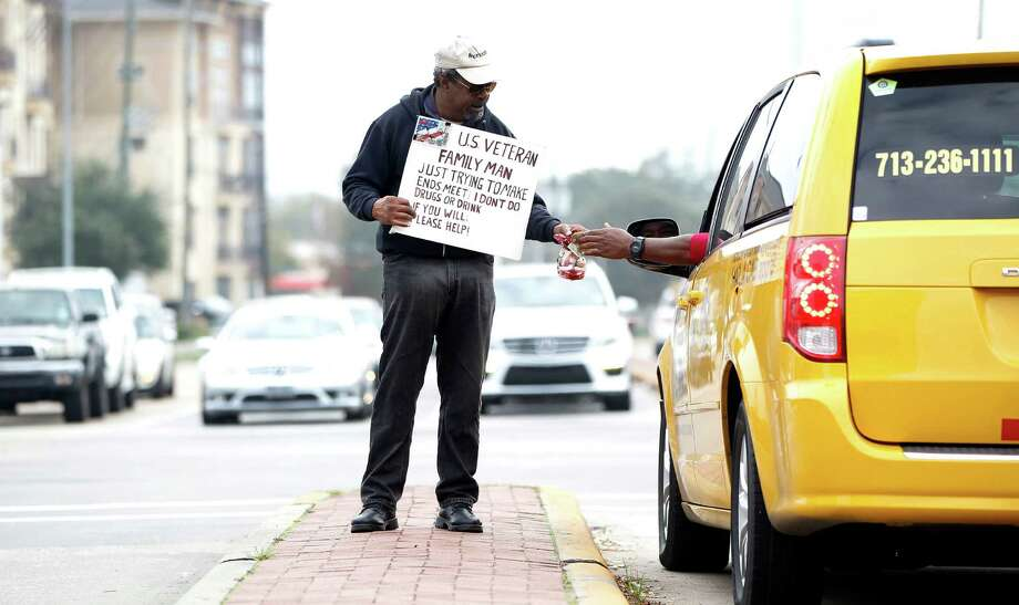 Richard Moten, who's been homeless on and off for years, hoped his message would resonate with drivers. Photo: Karen Warren, Staff / © 2015  Houston Chronicle