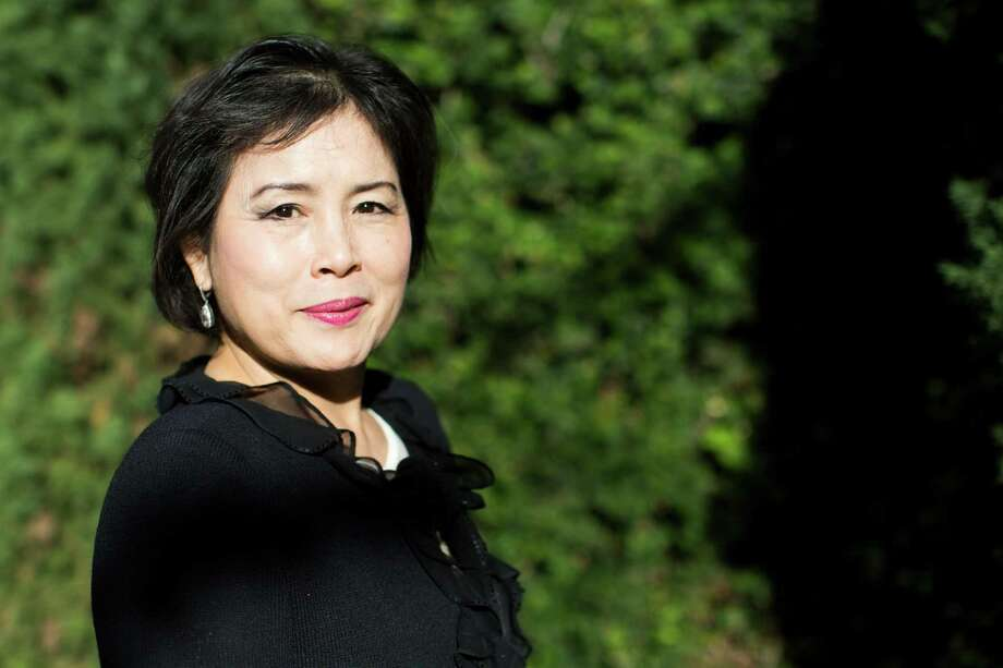 Jane Nguyen, 65, a Vietnamese refugee who tried three times to escape the communist nation until she finally made it to Thailand then to the United States. Nguyen says she felt welcomed to the United States and that she was glad to be out of a country that was constantly in conflict. Nguyen was a pharmacist in Vietnam, now she's the founder of Alpha Financial Group, a real estate agency and broker group serving the Vietnamese community. Thursday, Dec. 17, 2015, in Houston. ( Marie D. De Jesus / Houston Chronicle ) Photo: Marie D. De Jesus, Staff / © 2015 Houston Chronicle