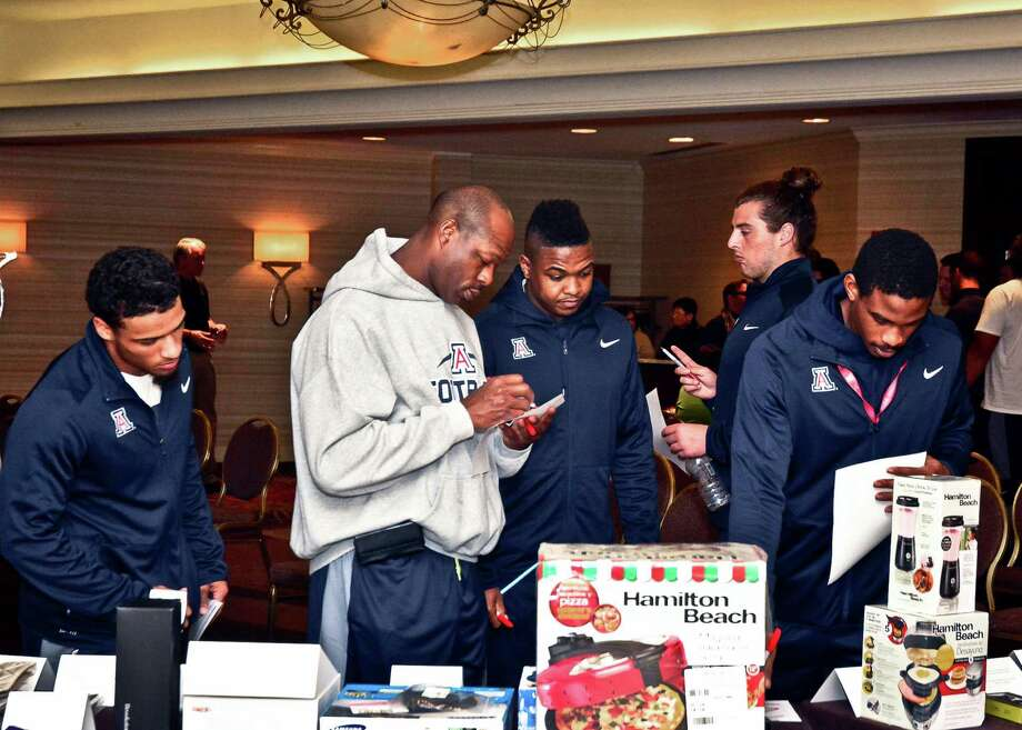 Members of the Arizona football team walk around the gift suite at the New Mexico Bowl last weekend. They selected their gifts before winning the game. Photo: JB Gallegos, HONS / The Gildan New Mexico Bowl