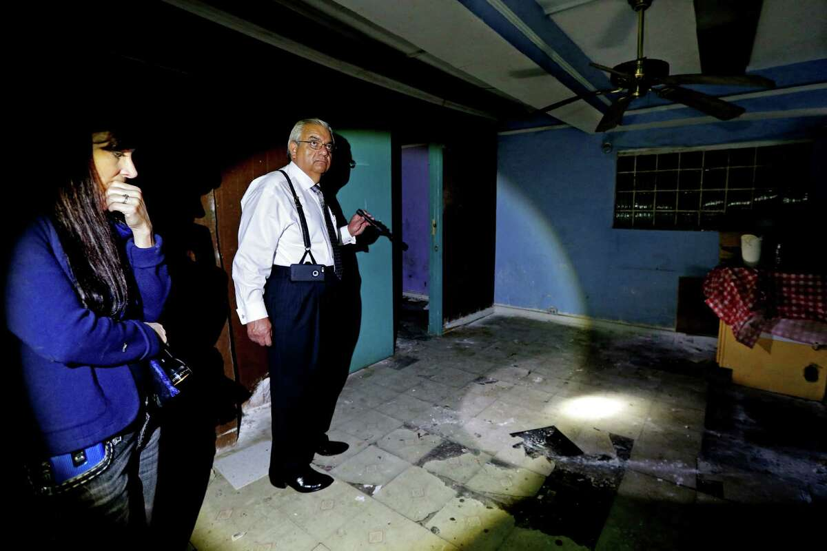 Shauna Dunlap, left, special agent Houston office of the FBI, shown with Ruben Perez, assistant United State Attorney Chief, civil rights/human trafficking unit, in a second floor room where girls under 18-years-old were held under pad locked doors and prostituted against their will at Las Palmas II, along the 5600 block of Telephone Road. The club was a former cantina and brothel, where Mexican and Central American women were held against their will, and subjected to beatings, rape and threats of further abuse if they didn?•t work as prostitutes. The site is one of the largest sex trafficking rings ever busted in Houston.