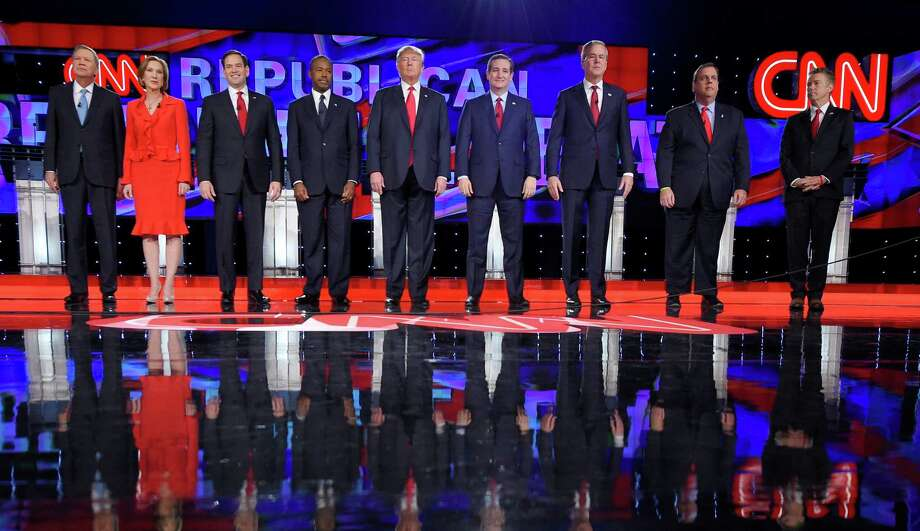 Republican presidential candidates John Kasich (left), Carly Fiorina, Marco Rubio, Ben Carson, Donald Trump, Ted Cruz, Jeb Bush, Chris Christie and Rand Paul take the stage during a debate Dec. 15 in Las Vegas. Photo: Mark J. Terrill / Associated Press / AP