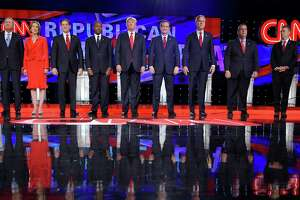 Republican presidential candidates John Kasich (left), Carly Fiorina, Marco Rubio, Ben Carson, Donald Trump, Ted Cruz, Jeb Bush, Chris Christie and Rand Paul take the stage during a debate Dec. 15 in Las Vegas.