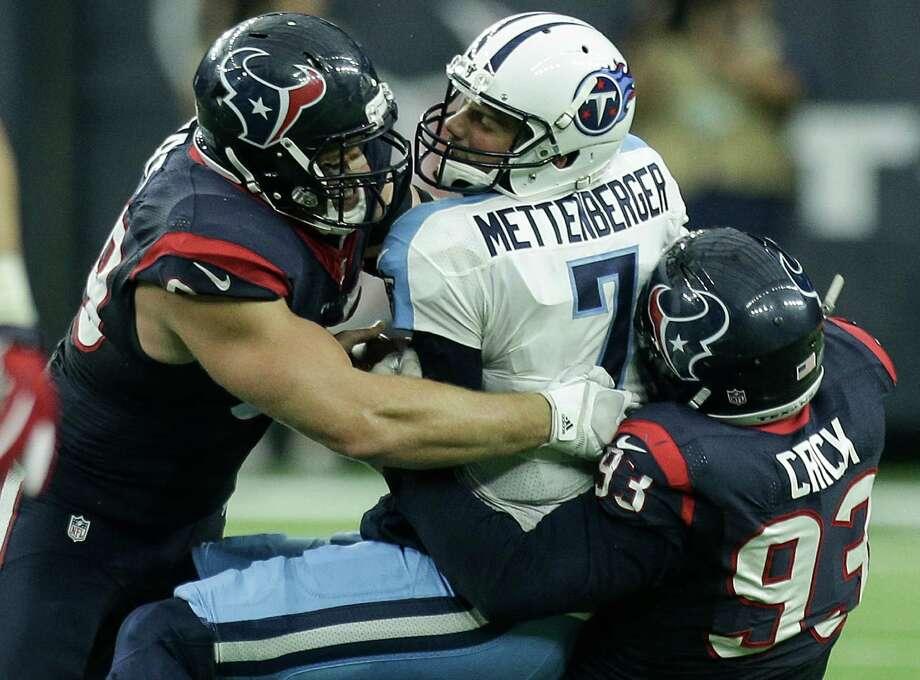 Defensive ends J.J. Watt, left, and Jared Crick have run into Titans QB Zach Mettenberger before. Photo: Brett Coomer, Staff / © 2015  Houston Chronicle
