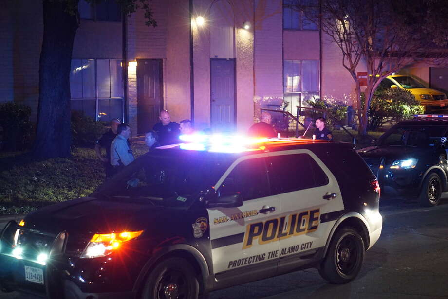Police investigate a shooting that occurred Christmas night 2015 in the 1300 block of Donaldson. A 60-year-old man was in critical condition with gunshot wounds to the abdomen and buttocks after h e was involved in an argument with a neighbor, police said. Photo: Jacob Beltran / San Antonio Express-News