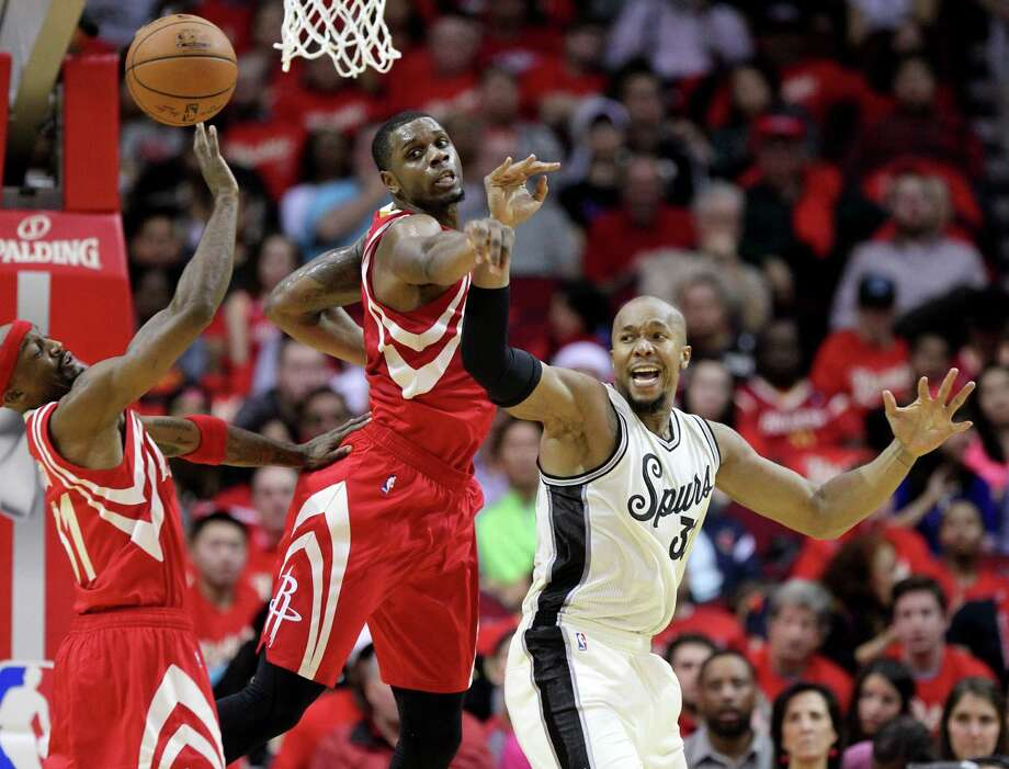 In a scramble for a loose ball, the Rockets' Jason Terry, left, and Terrence Jones along with the Spurs' David West come up empty-handed Friday night. Photo: Gary Coronado, Staff / © 2015 Houston Chronicle