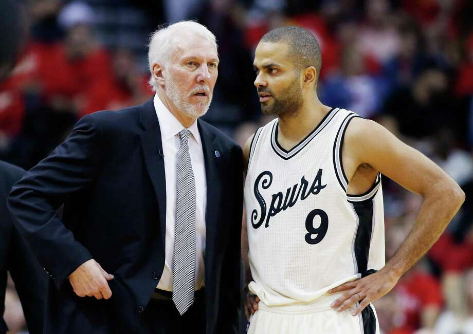 HOUSTON, TX - DECEMBER 25:  Head coach Gregg Popovich of the San Antonio Spurs chats with Tony Parker #9 during their game against the Houston Rockets at the Toyota Center on December 25, 2015 in Houston, Texas. NOTE TO USER: User expressly acknowledges and agrees that, by downloading and or using this Photograph, user is consenting to the terms and conditions of the Getty Images License Agreement. Photo: Scott Halleran, Getty Images / 2015 Getty Images