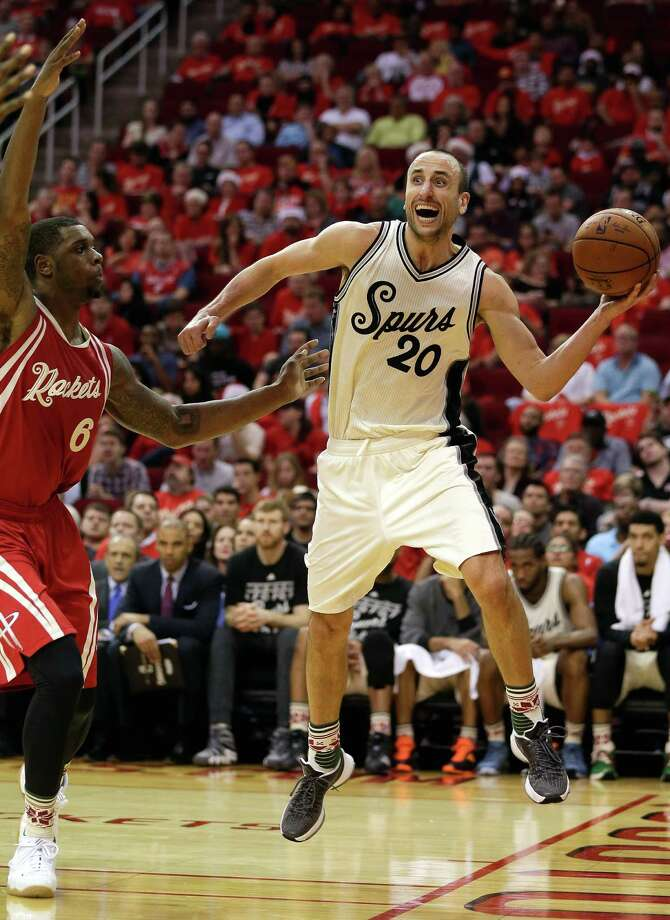 2833 x 3887~~$~~San Antonio Spurs guard Manu Ginobili (20) looks to pass as Houston Rockets forward Terrence Jones (6) forces him out of bounds in the second half of an NBA basketball game Friday, Dec. 25, 2015, in Houston. Houston won 88-84. Photo: Bob Levey, AP / FR156786 AP