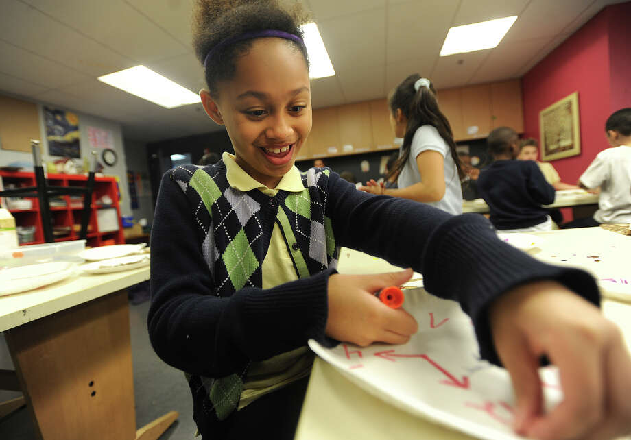 Morgan Grey, 8, of Bridgeport, makes a clock as an art project as she and fellow class members learn to tell time in their after school club at the Wakeman Boy's and Girls Club Smilow-Burroughs Clubhouse in Bridgeport on Dec. 8. Photo: Brian A. Pounds / Hearst Connecticut Media / Connecticut Post