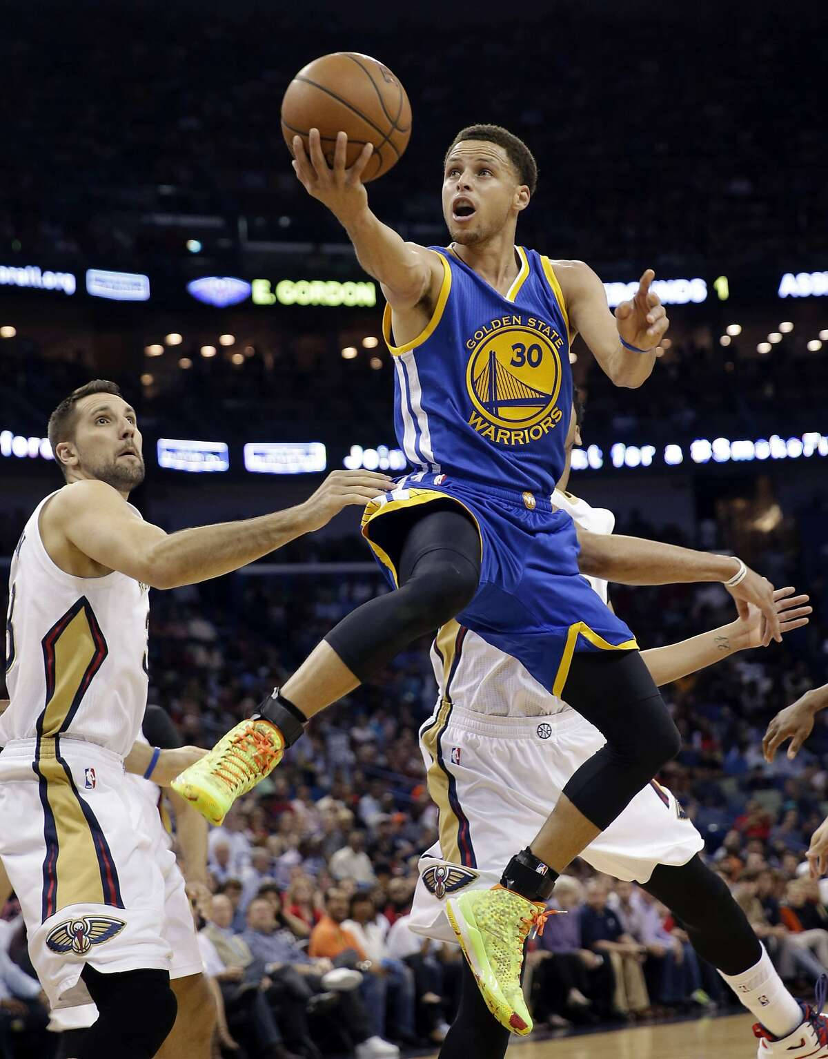 FILE - In this April 7, 2015, file photo, Golden State Warriors guard Stephen Curry (30) drives to the basket in front of New Orleans Pelicans forward Ryan Anderson in the first half of an NBA basketball game in New Orleans. Curry has been named The Associated Press 2015 Male Athlete of the Year. (AP Photo/Gerald Herbert, File)