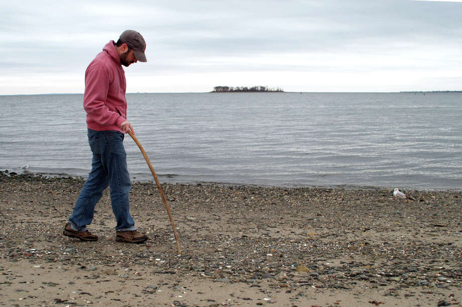 Kierran Broatch, of Milford, looks for peices of sea glass and other interesting things, like driftwood, that might have washed up at Gulf Beach in Milford, Conn. | File Photo Photo: Christian Abraham, Hearst Connecticut Media / Connecticut Post