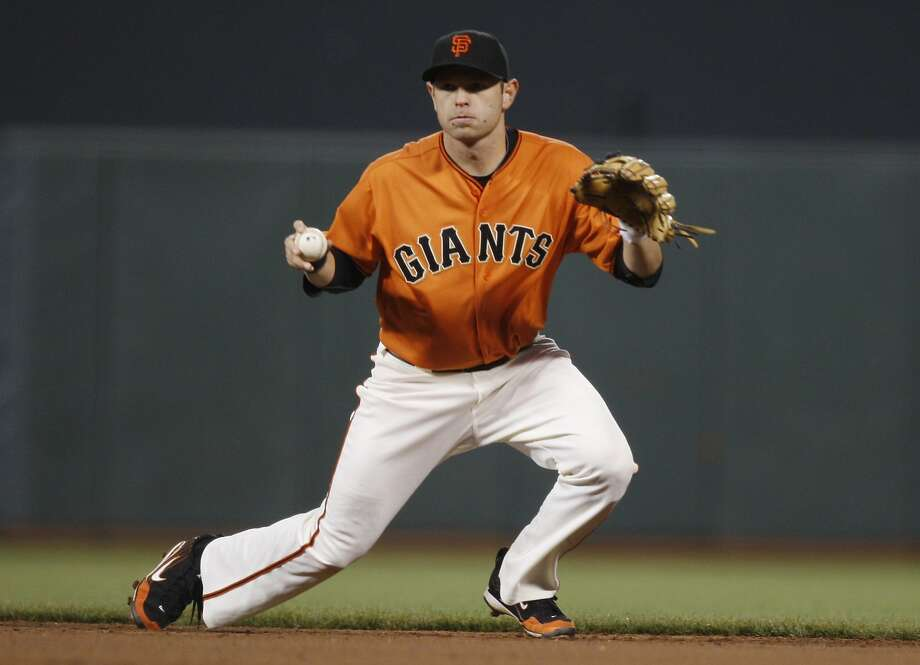 Freddy Sanchez comes up with a grounder to throw the runner out at first base in the top of fourth inning as the San Francisco Giants take on the Colorado Rockies at AT&T Park in San Francisco Calif on Friday, May 6, 2011. Photo: Alex Washburn, The Chronicle
