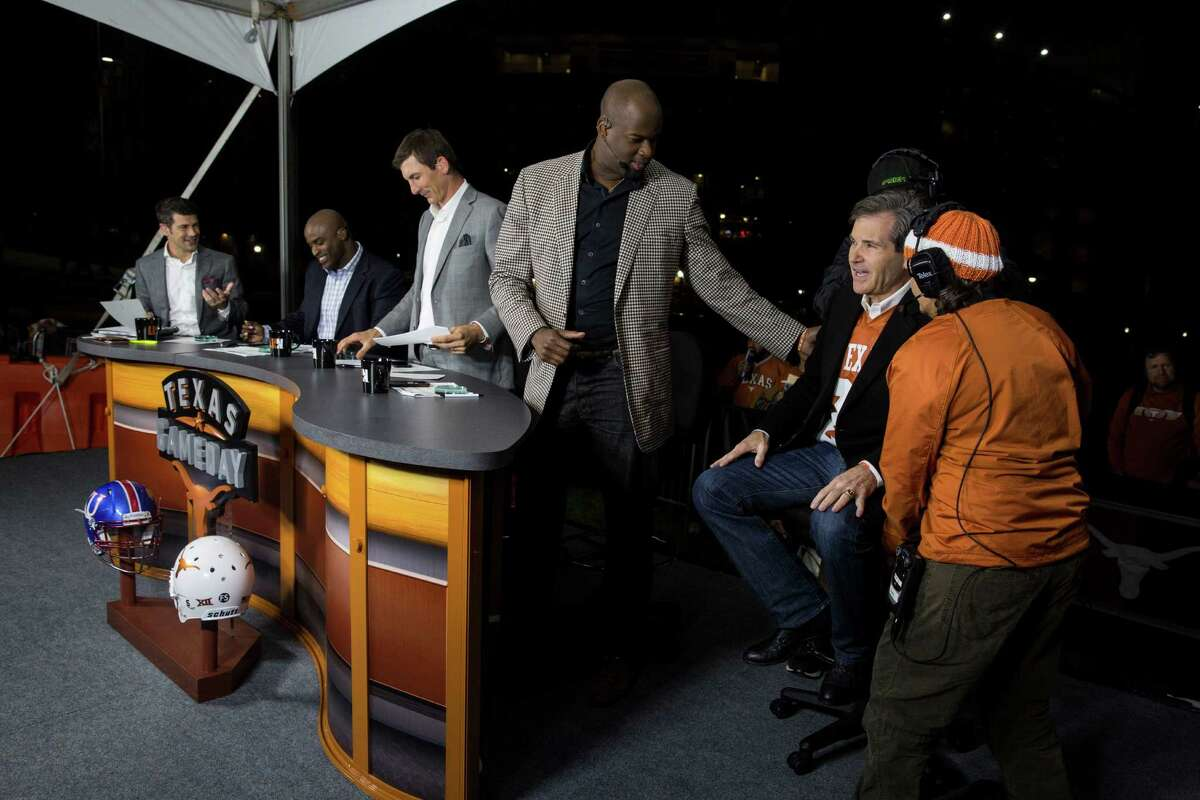 Shelly Lemkowitz, far right, gets guest Bobby Mitchell in place next to announcer Vince Young for filming during the Longhorn Network