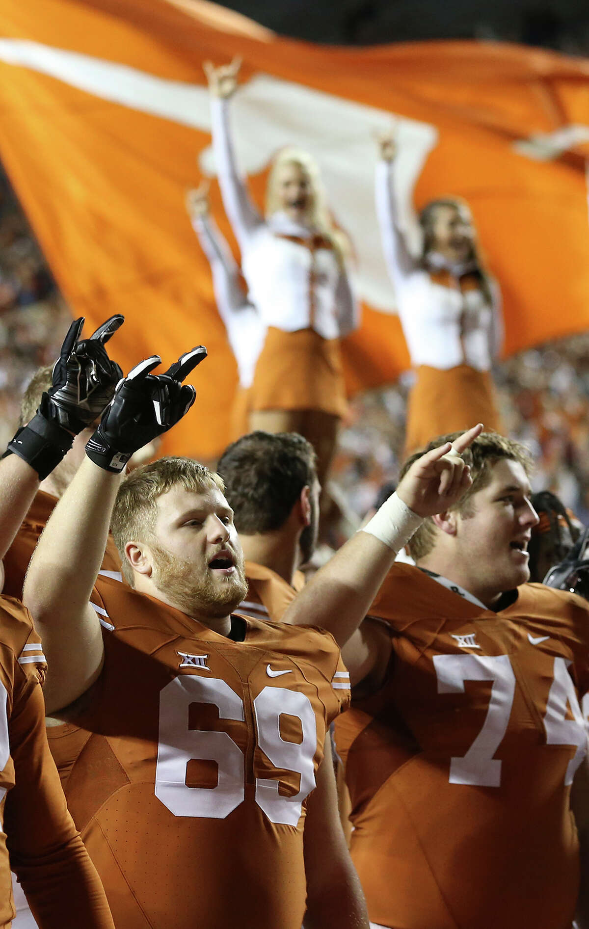 RIGHT: Longhorns celebrate a win as Texas hosts Kansas at DKR Stadium on November 7, 2015.