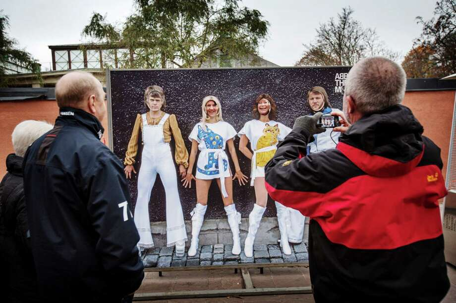 Visitors pause for a photo opportunity at the cashless Abba Museum in Stockholm in November. Few places are tilting toward a cashless future as quickly as Sweden, which has become hooked on the convenience of paying by plastic and mobile apps.  Photo: LINUS SUNDAHL-DJERF, STR / NYTNS