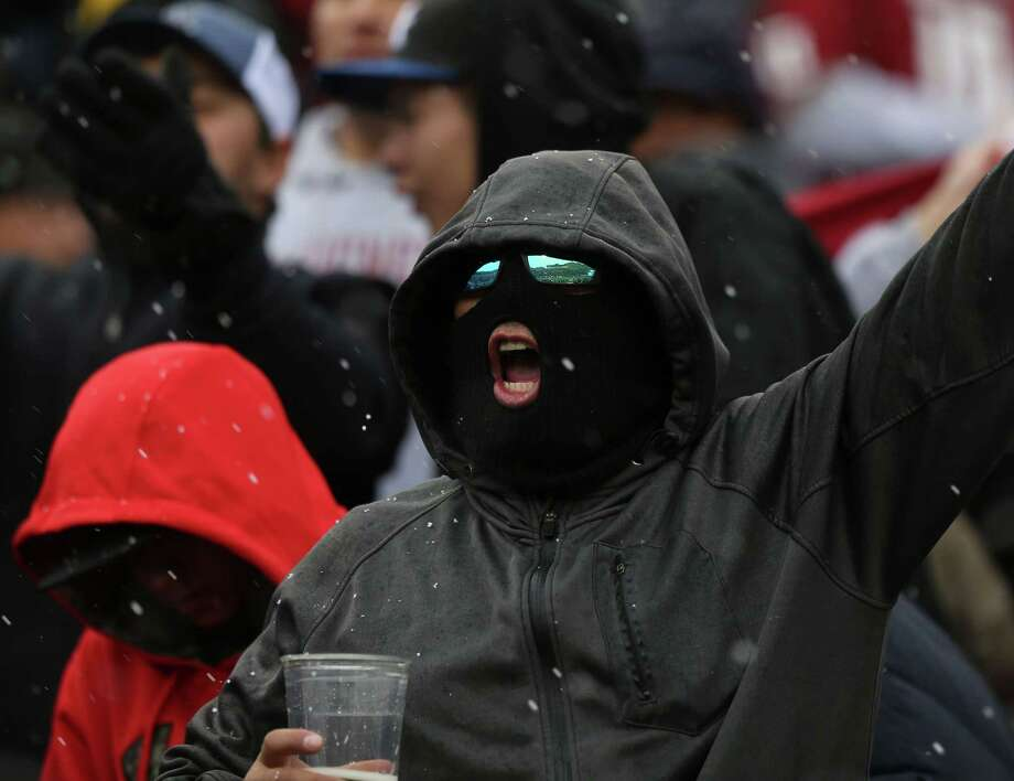 Fans cheered through falling snow during the first half of the Sun Bowl NCAA college football game Saturday Dec. 26, 2015 in El Paso, Texas. (AP Photo/Victor Calzada) Photo: Victor Calzada, FRE / Associated Press / FR39270 AP