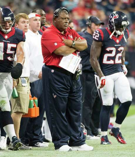 Romeo Crennel's defense struggled early in the season but found its footing in Week 8 against the Titans, who the Texans face again today. Photo: Smiley N. Pool, Staff / © 2014  Houston Chronicle