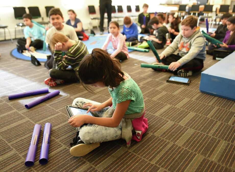 Fourth-graders at Hamilton Avenue School works on iPads during school. The district estimates about 40 students in the district don't have Internet access at home and plan to subsidize those families during the school year. Photo: Tyler Sizemore / File Photo / Greenwich Time