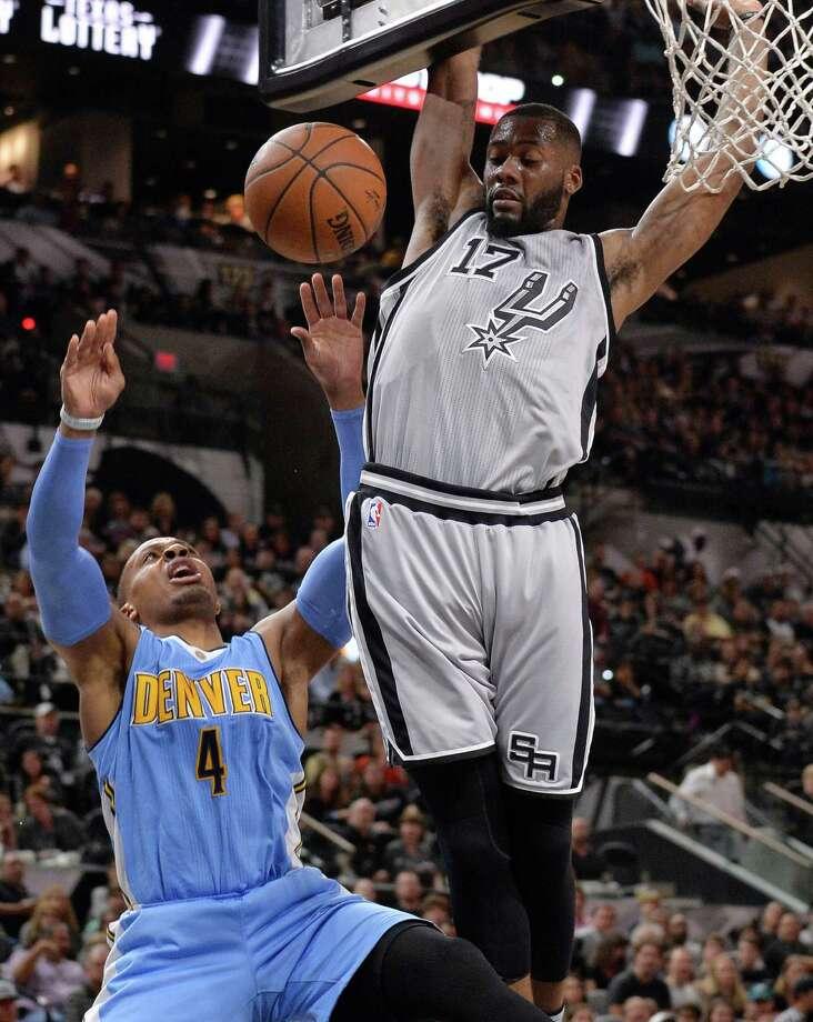 Denver Nuggets guard Randy Foye (4) is fouled by San Antonio Spurs forward Jonathon Simmons during the first half of an NBA basketball game, Saturday, Dec. 26, 2015, in San Antonio. (AP Photo/Darren Abate) Photo: Darren Abate, Associated Press / FR115 AP