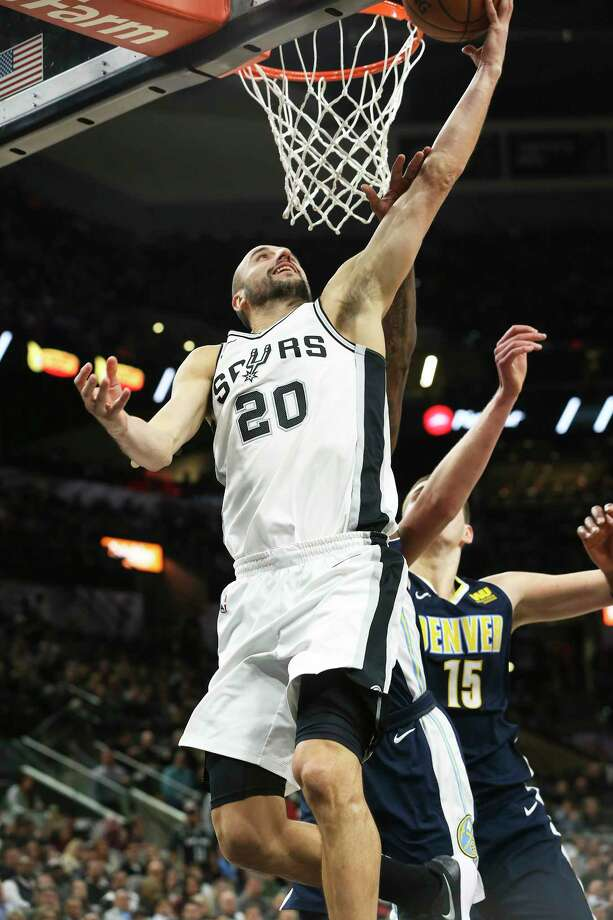 Manu Ginobili gets tot he hoop in the first half as the Spurs play Denver at the AT&T Center on January 30, 2018. Photo: Tom Reel, San Antonio Express-News / 2017 SAN ANTONIO EXPRESS-NEWS