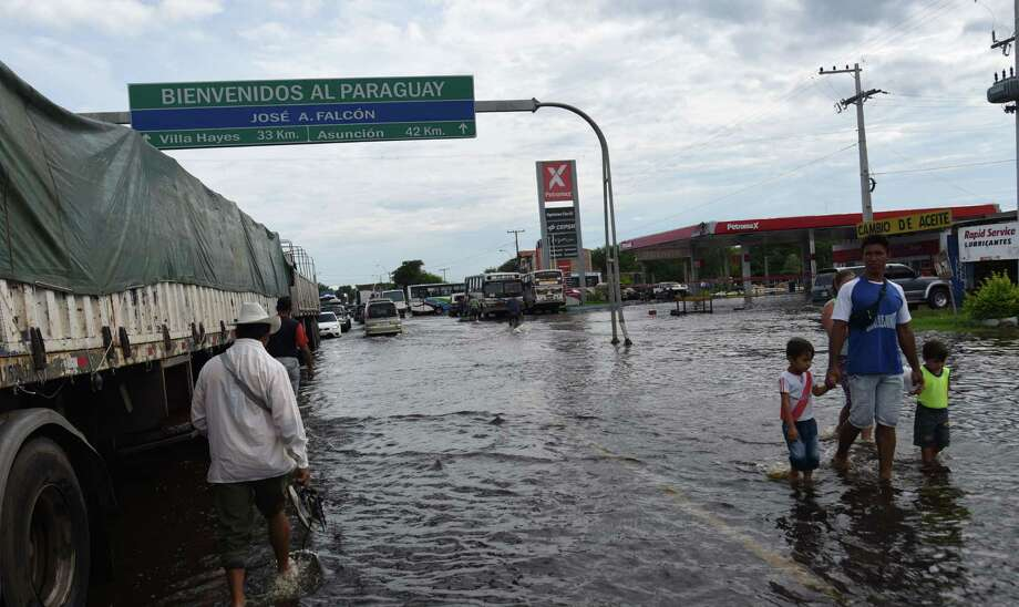 Torrential rains dampened Christmas for many residents on the Paraguay- Argentina border as flooding forced 140,000 from their homes. Photo: Norberto Duarte / Getty Images / NORBERTO DUARTE