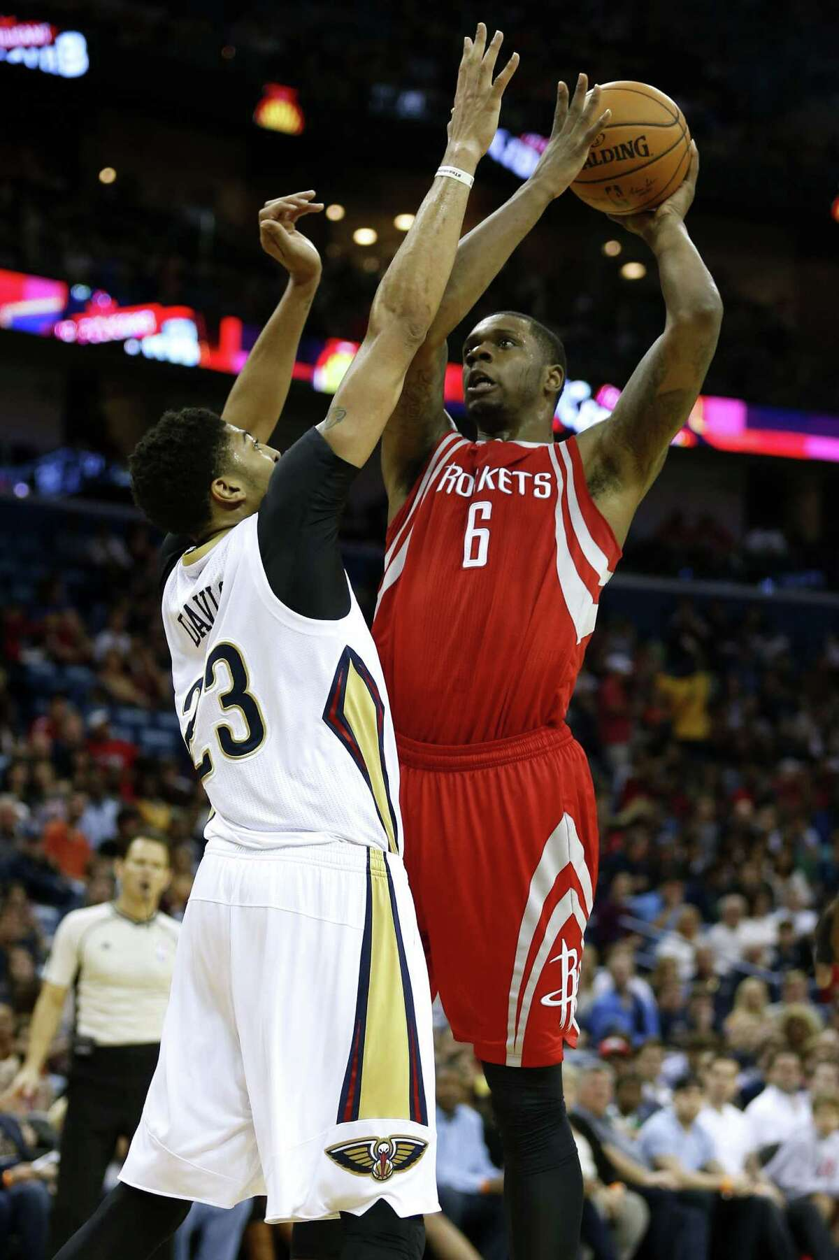 The Rockets' Terrence Jones, right, drives on Anthony Davis of the Pelicans. Jones had 13 points on 4-for-12 shooting off the bench in the 110-108 loss.