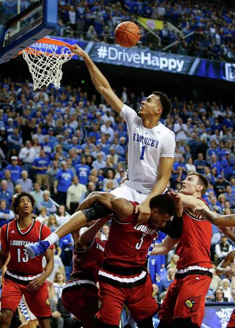 Kentucky forward Skal Labissiere attempts a dunk, but it shot off the back of the rim. The Wildcats went on to defeat Louisville 75-73 on Saturday. Photo: Mark Cornelison, MBR / Lexington Herald-Leader