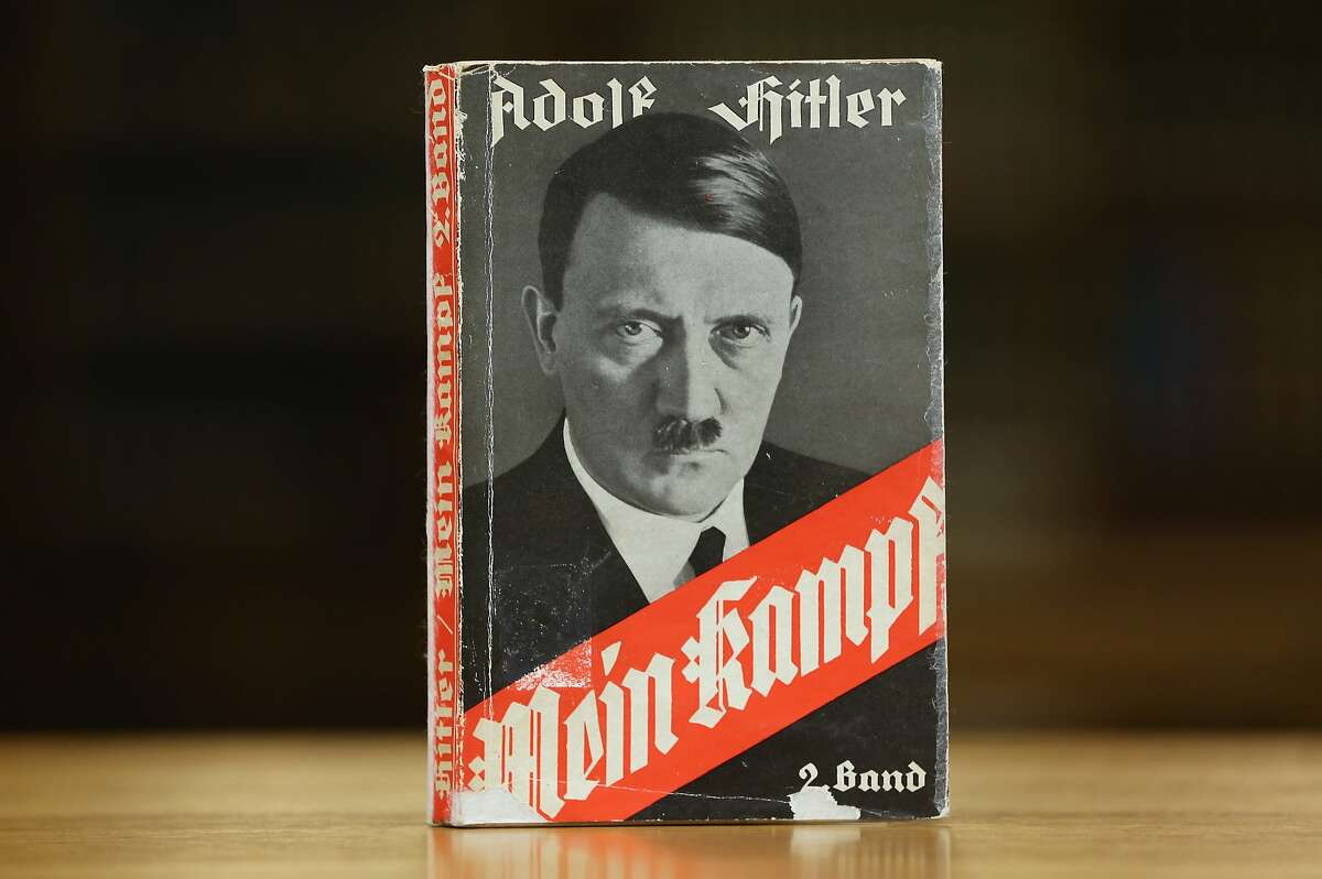 """A 1941 edition of Adolf Hitler's """"Mein Kampf"""" (""""My Struggle"""") stands at the library of the Deutsches Historisches Museum (German Historical Museum). Last month it was discovered that the New York Times once published a puff piece on Adolf Hitler summering in his mountain retreat """"in the clouds."""""""