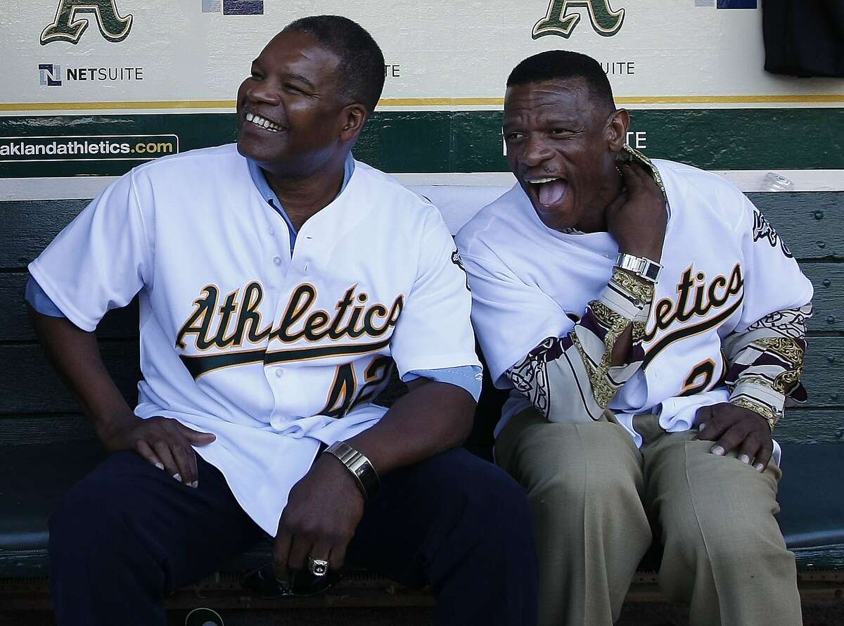 Dave Henderson (left) and Rickey Henderson celebrate the 20th anniversary of the 1989 World Series.