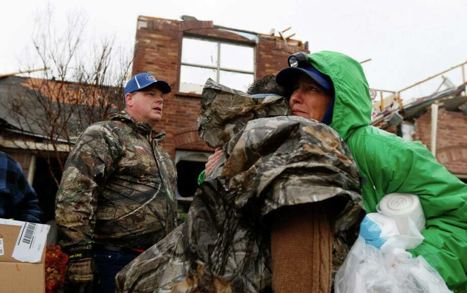 Cheryl Turek, of Nevada, Texas, right, hugs Evelyn Lindstrom in front of Lindstrom's destroyed home in Copeville, Texas, after heavy rain, high winds and tornados swept through North Texas the previous night, on Sunday, Dec. 27, 2015. (Rachel Woolf/The Dallas Morning News via AP) MANDATORY CREDIT; MAGS OUT; TV OUT; INTERNET USE BY AP MEMBERS ONLY; Photo: Rachel Woolf, AP / The Dallas Morning News