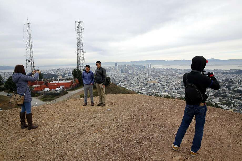 Tourists take photos at Twin Peaks in San Francisco, California, on Sunday, Dec. 27, 2015. Photo: Connor Radnovich, The Chronicle