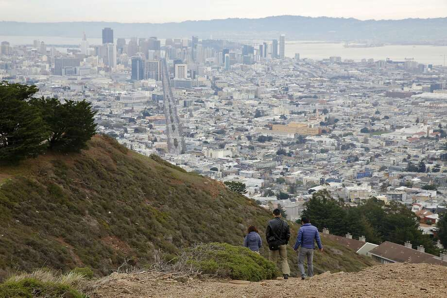 Tourists hike at Twin Peaks in San Francisco, California, on Sunday, Dec. 27, 2015. Photo: Connor Radnovich, The Chronicle