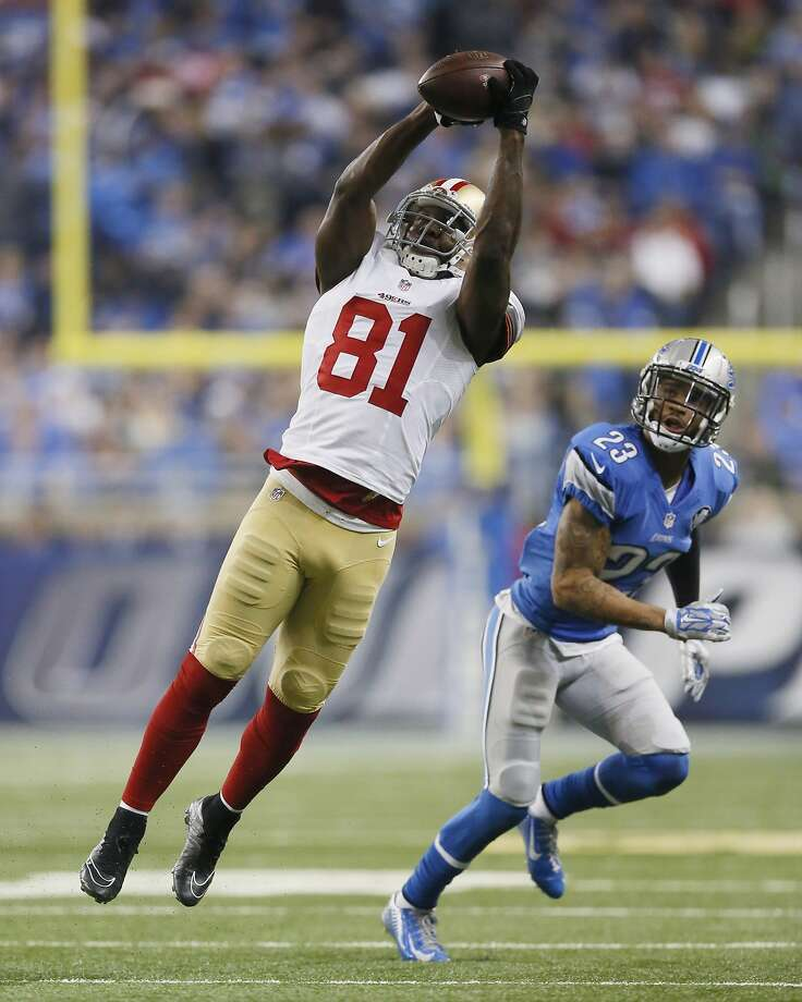 San Francisco 49ers wide receiver Anquan Boldin (81) catches a pass defended by Detroit Lions cornerback Darius Slay (23) during the first half of an NFL football game, Sunday, Dec. 27, 2015, in Detroit. (AP Photo/Duane Burleson) Photo: Duane Burleson, Associated Press
