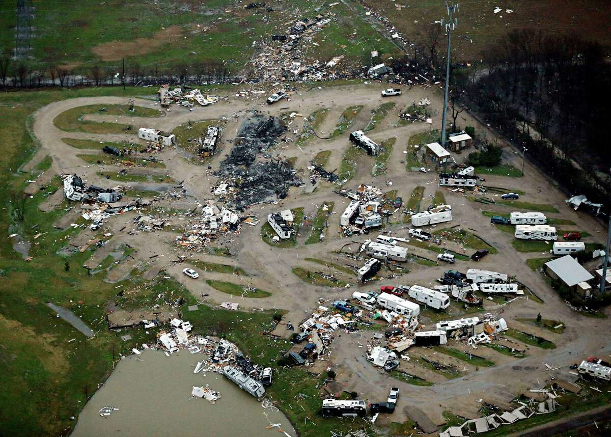 Tornado damage is seen in a mobile home park on Sunday, Dec. 27, 2015, in Garland, Texas. Violent storms ripped through the North Texas area late Saturday, spawning tornados that killed 11 people. (G.J. McCarthy/Dallas Morning News/TNS)