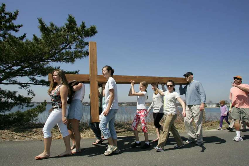 Members of the First Congregational Church in Old Greenwich carried a cross that will be used in Sunday's sunrise service from the church to Greenwich Point Friday afternoon.