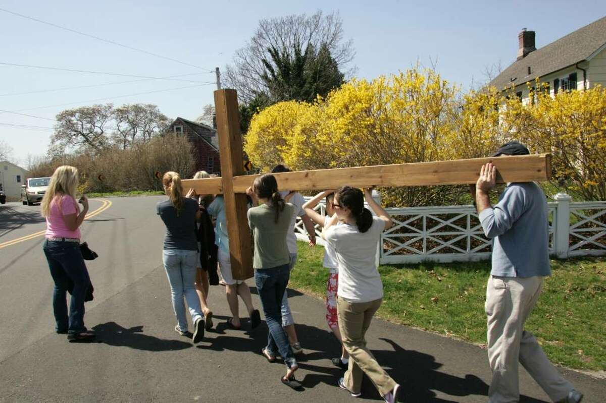Members of the First Congregational Church in Old Greenwich make thier way to Greenwich Point with a cross that will be used in Sunday's sunrise service.