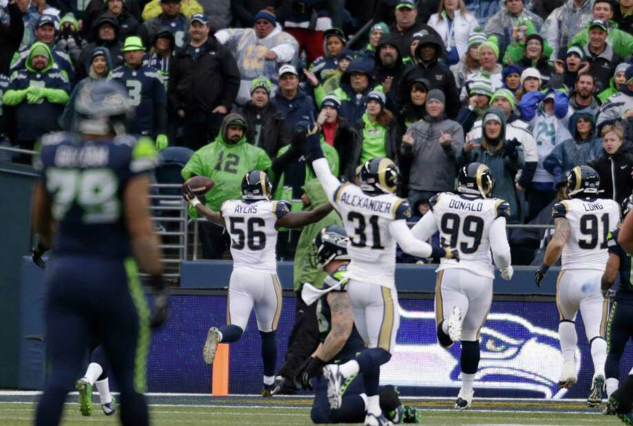 St. Louis Rams' Akeem Ayers (56) raises his arms as he scores on a fumble recovery against the Seattle Seahawks in the first half of an NFL football game, Sunday, Dec. 27, 2015, in Seattle. (AP Photo/John Froschauer) Photo: John Froschauer, Associated Press / FR74207 AP