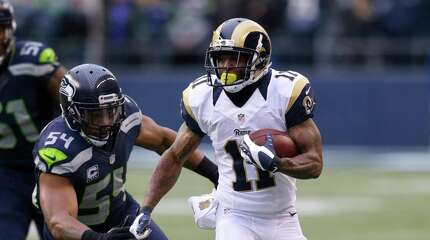 St. Louis Rams' Tavon Austin runs with the ball as Seattle Seahawks' Bobby Wagner gives chase in the first half of an NFL football game, Sunday, Dec. 27, 2015, in Seattle. (AP Photo/Stephen Brashear)