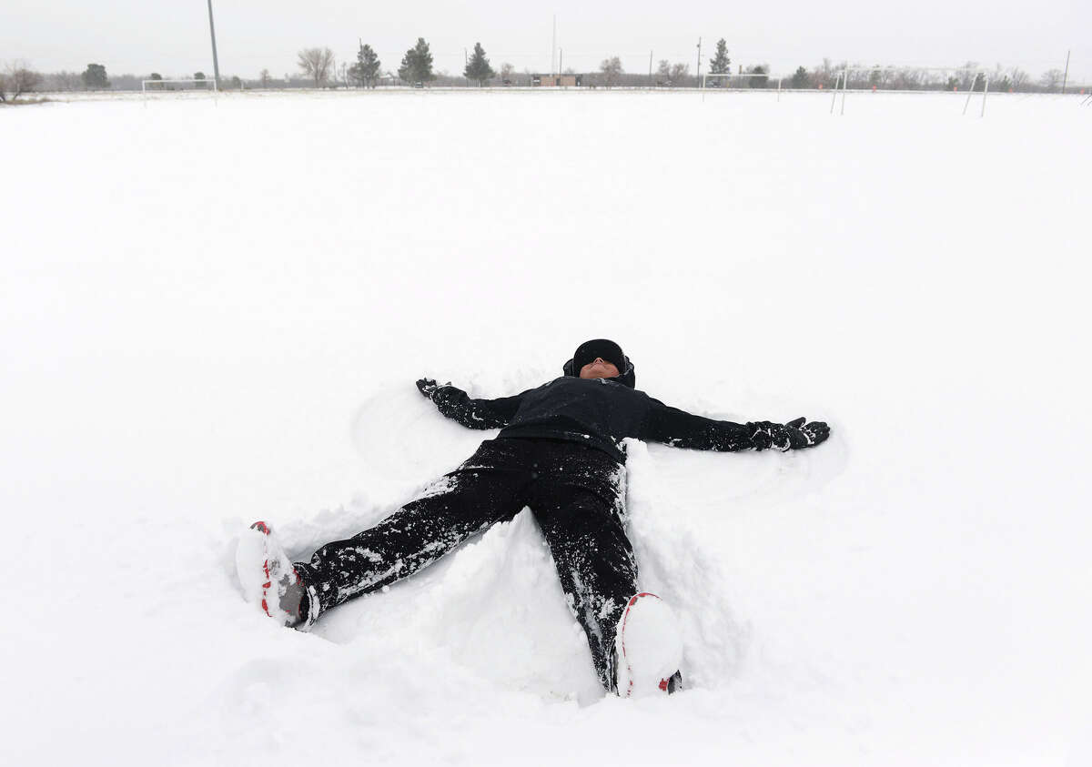 Brandon Dominguez makes a snow angel on Sunday, Dec. 27, 2015 at McKinney Park in Odessa, Texas. Nearly all of Interstate 40 in Texas, the main east-west highway through the Texas Panhandle, has been shut because of the snowstorm pummeling the area. The Texas Department of Public Safety says only a small section of the highway within Amarillo is not closed.