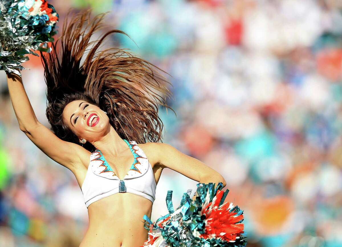 MIAMI GARDENS, FL - DECEMBER 27: A Miami Dolphins cheerleader performs during the second half of the game against the Indianapolis Colts at Sun Life Stadium on December 27, 2015 in Miami Gardens, Florida.